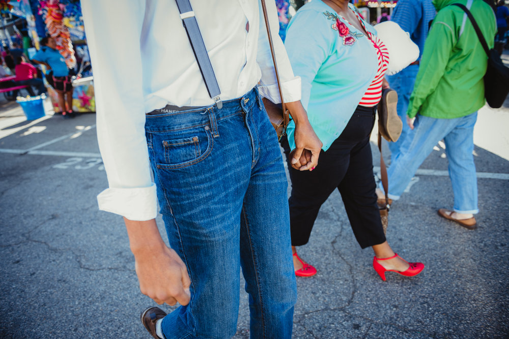 holding-hands-at-the-NC-State-Fair.jpg