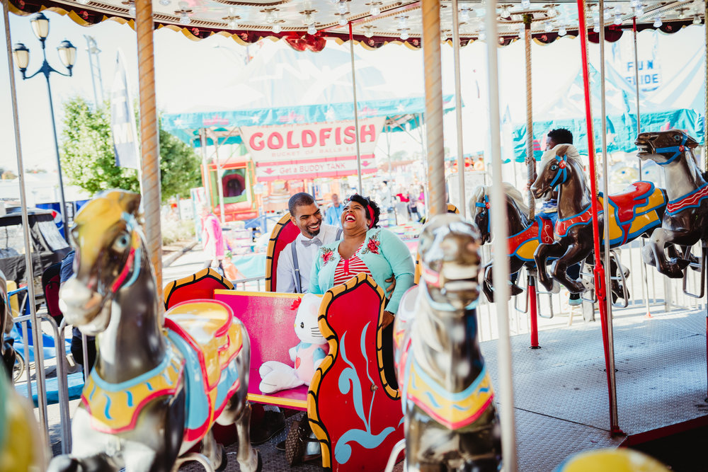 having-a-blast-during-our-photo-session-while-riding-the-carousel-at-the-NC-State-fair.jpg