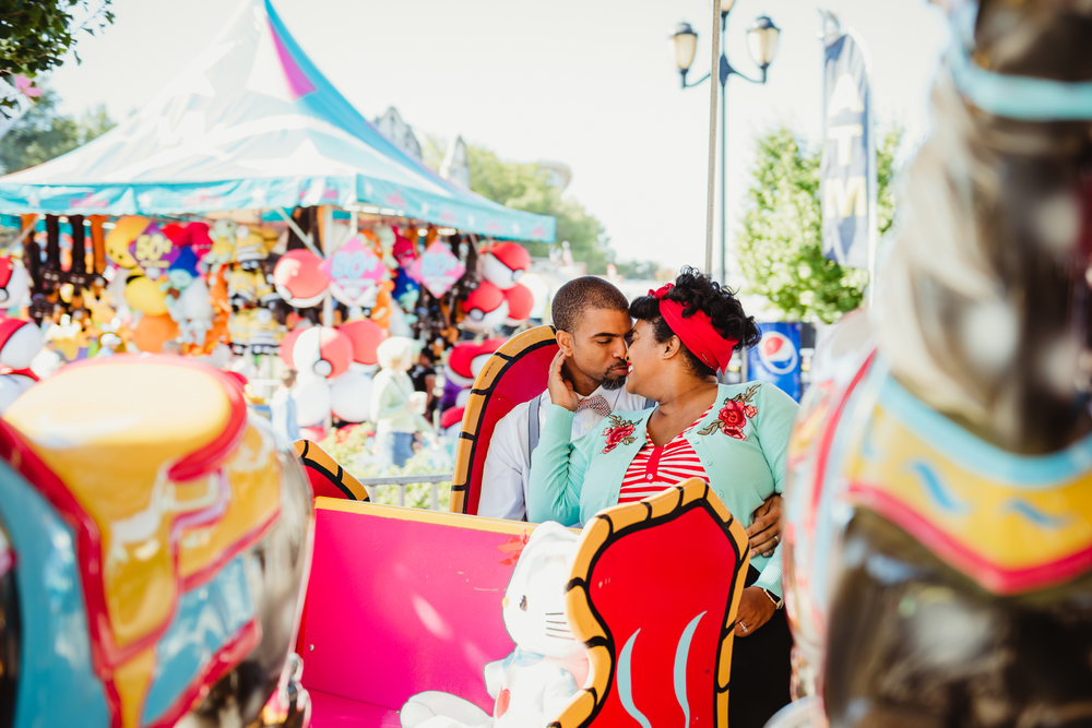 going-in-for-a-kiss-while-riding-the-carousel-at-the-NC-State-fair.jpg