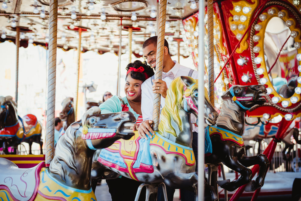 a-sweet-snuggle-while-riding-the-carousel-at-the-NC-State-fair.jpg