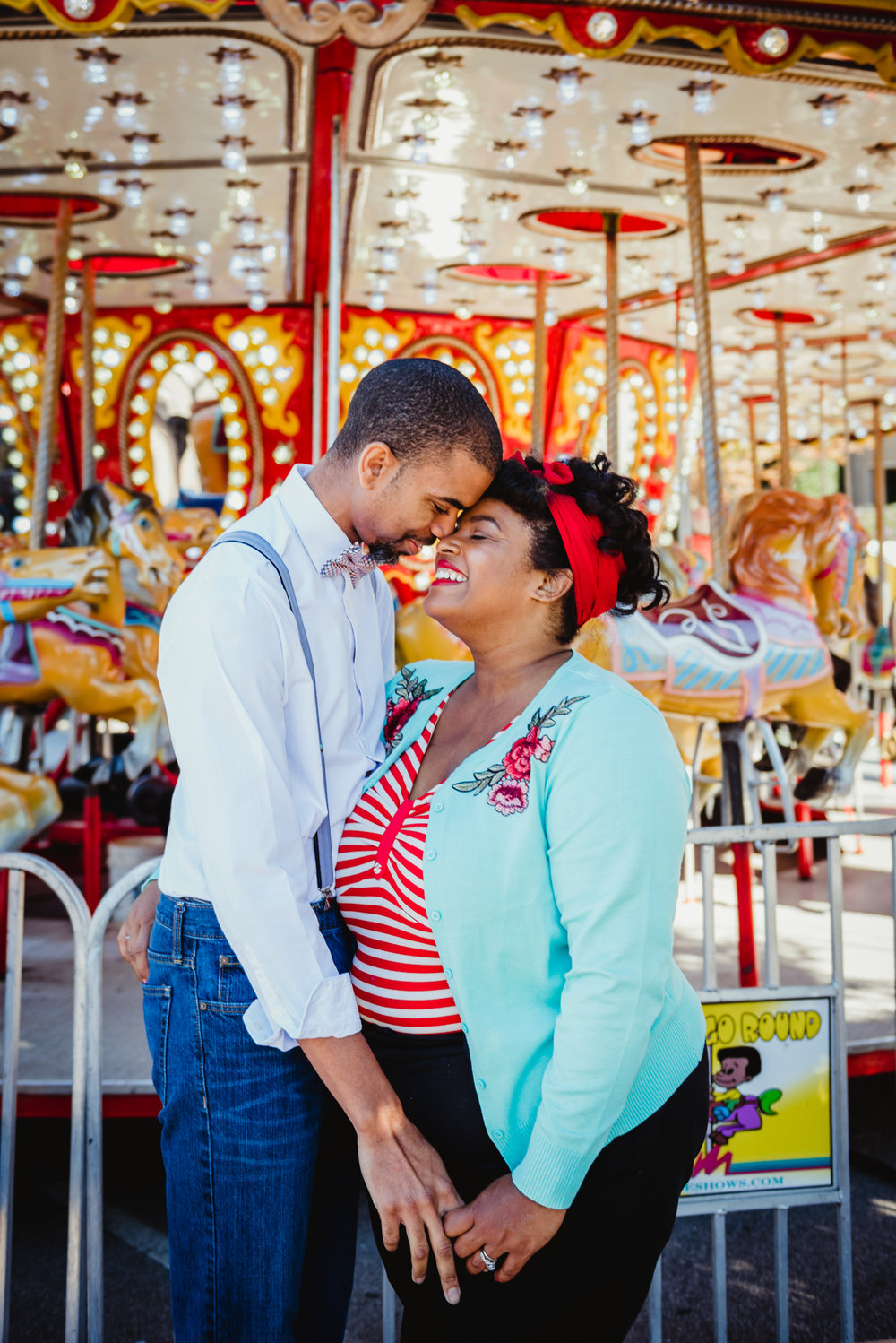 the-sweetest-anniversary-session-at-the-carousel-at-the-NC-State-fair.jpg