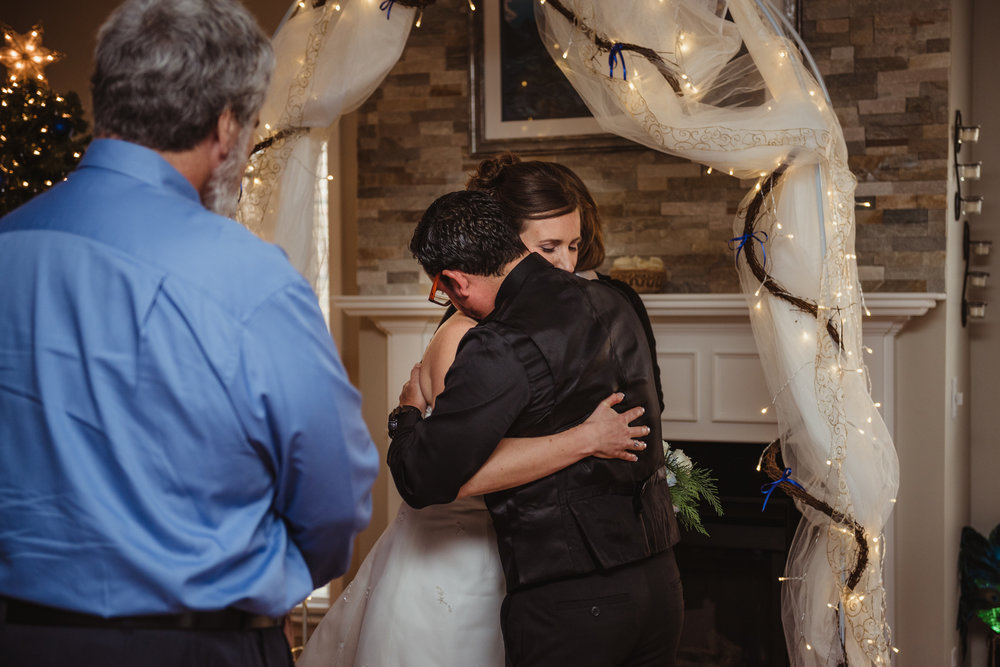 the-bride-and-groom-embrace-when-they-first-see-each-other-at-their-intimate-home-wedding-in-Raleigh.jpg