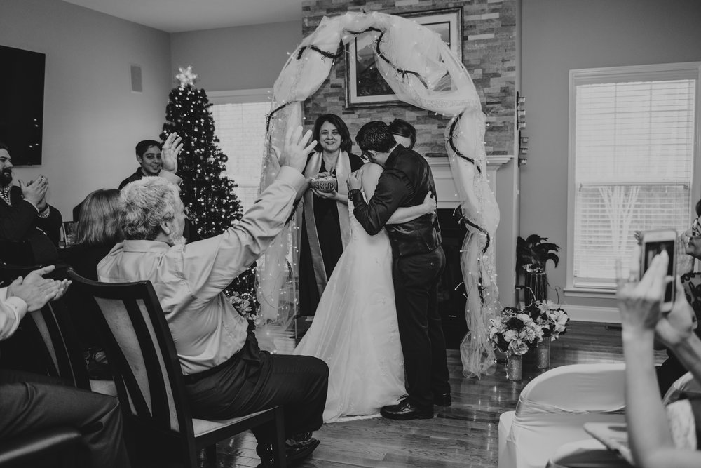 the-bride-and-groom-embrace-after-their-vows-at-their-intimate-home-wedding-in-Raleigh.jpg