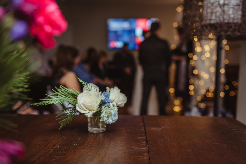 small-wedding-flowers-adorn-the-kitchen-at-their-intimate-home-wedding-in-Raleigh.jpg