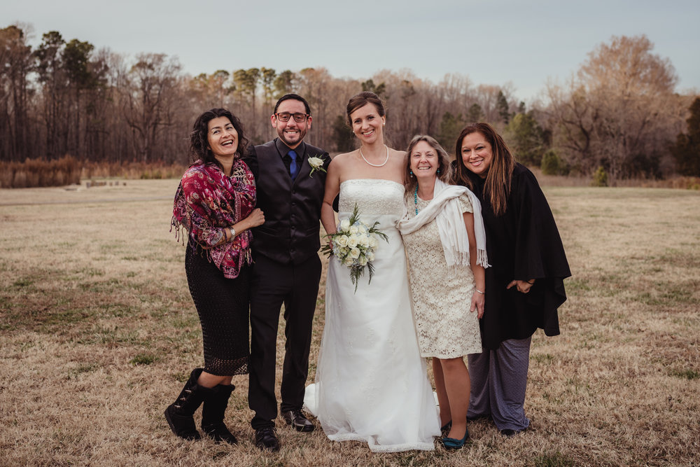 the-bride-and-groom-with-their-friends-in-the-park-in-Raleigh.jpg