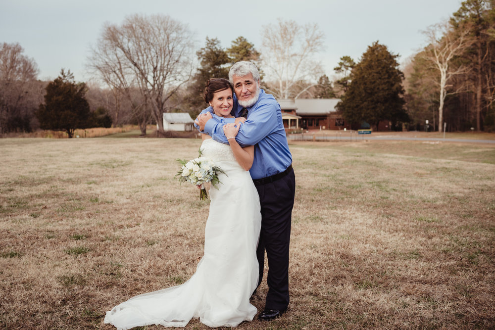 the-bride-and-her-father-in-the-park-in-Raleigh.jpg