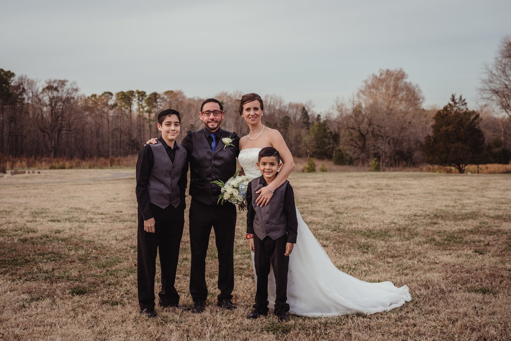 the-now-family-of-four-in-the-park-after-their-intimate-home-ceremony-in-Raleigh.jpg