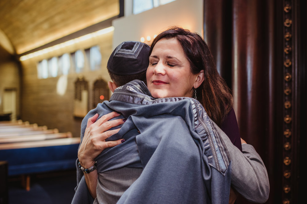 Noah's Mom gives him a hug before his bar mitzvah ceremony at Temple Beth Or in Raleigh.
