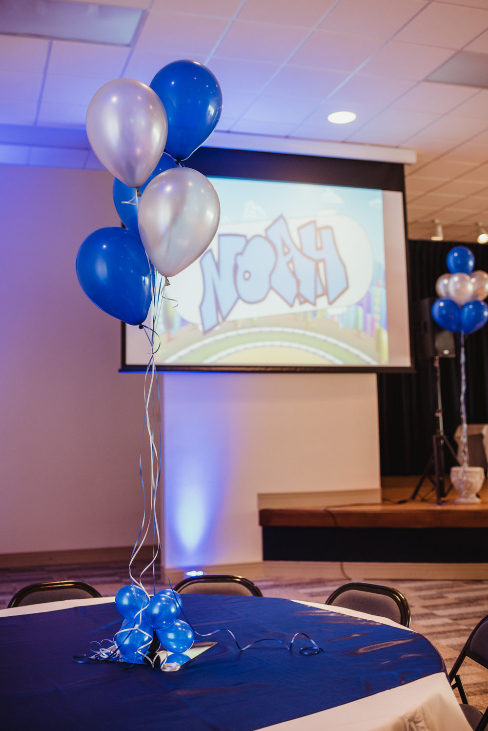 Blue and silver balloons make a stunning centerpiece at the celebration for Noah becoming bar mitzvah at Temple Beth Or.