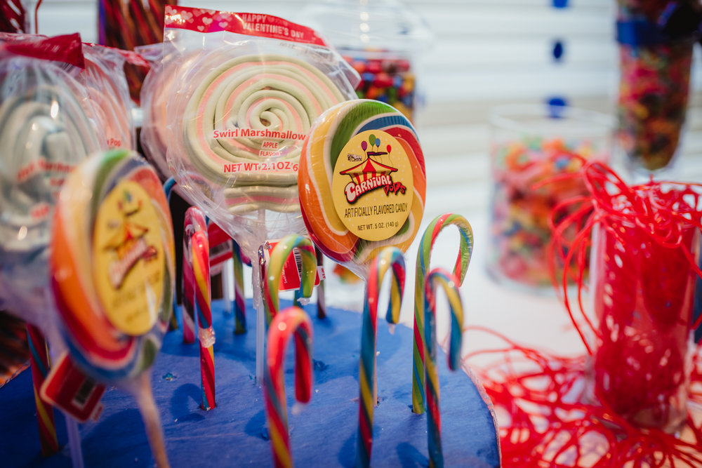 carnival pops and licorice shoelaces adorn the candy table for Noah's bar mitzvah reception.