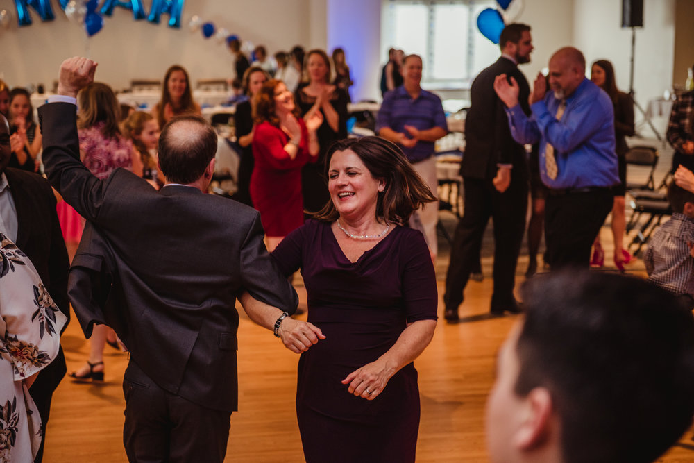 Mom and Dad dance after the hora during the bar mitzvah reception at Temple Beth Or in Raleigh.