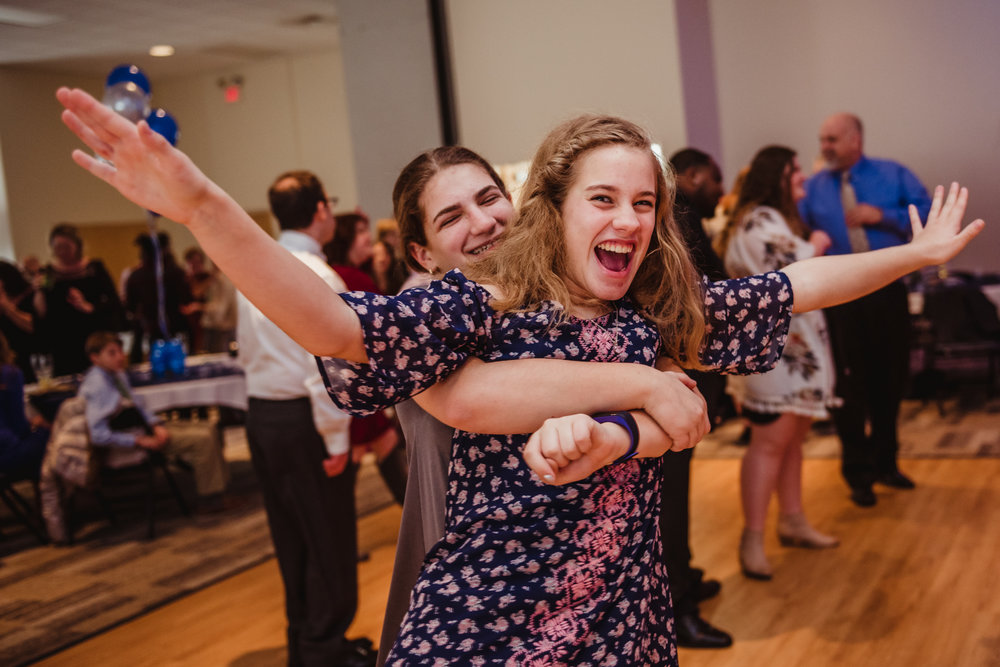 Kids are having a great time during the bar mitzvah reception at Temple Beth Or in Raleigh.