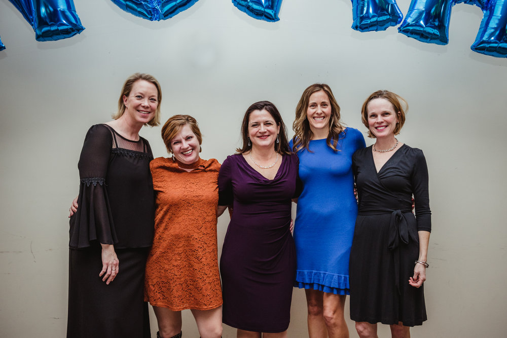 Friends pose for a group picture during the bar mitzvah reception at Temple Beth Or in Raleigh.