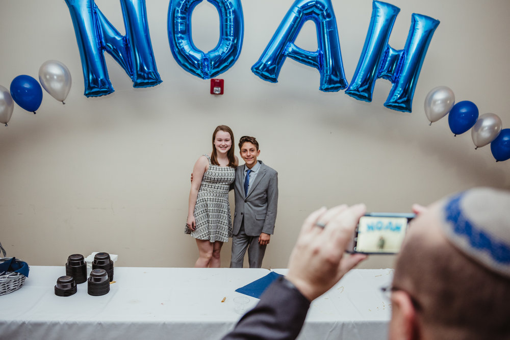 Noah poses with a friend during his bar mitzvah reception at Temple Beth Or in Raleigh.