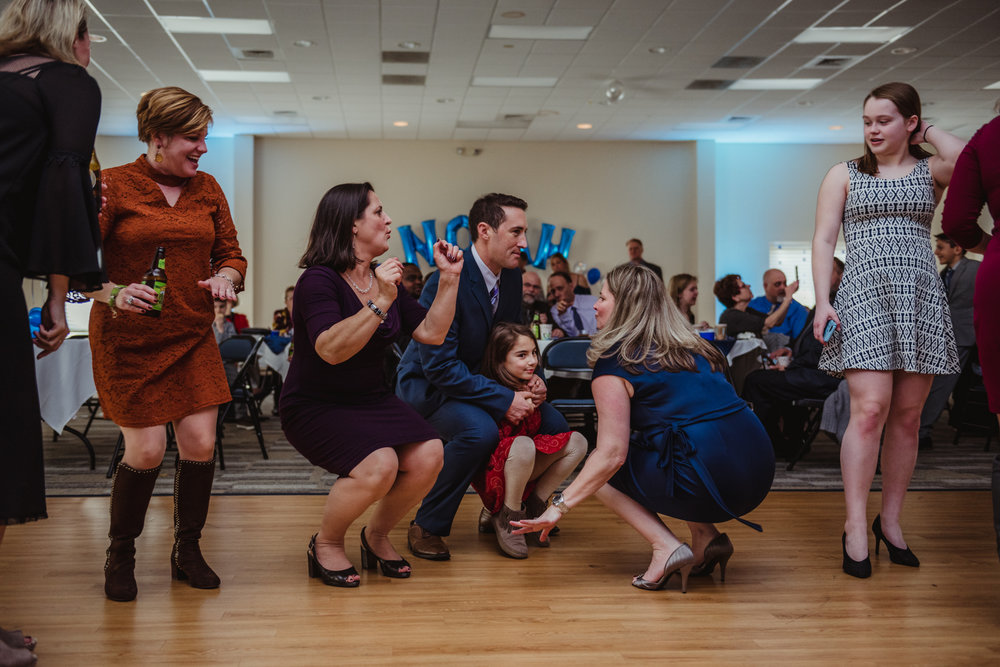 Family and friends dance down low during the bar mitzvah reception at Temple Beth Or in Raleigh.