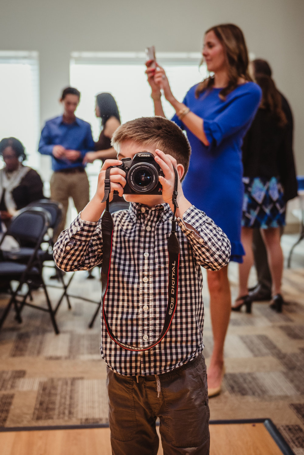 A boy takes a picture of me while I take a picture of him during the mitzvah celebration at Temple Beth Or.