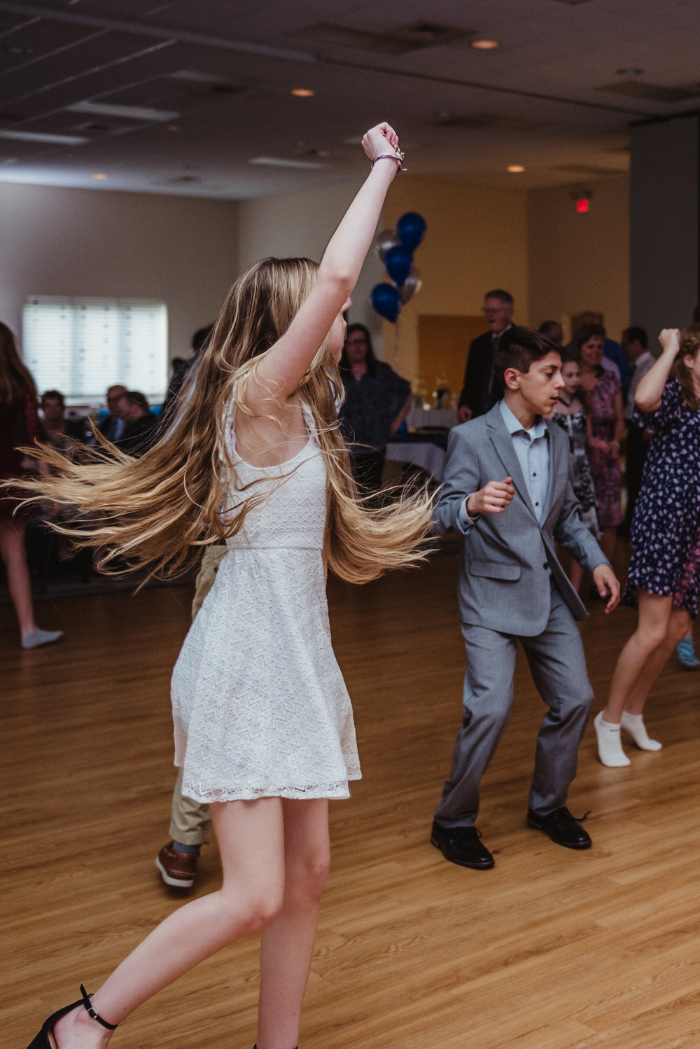 Noah and his guests dance to current songs during the bar mitzvah reception at Temple Beth Or in Raleigh.