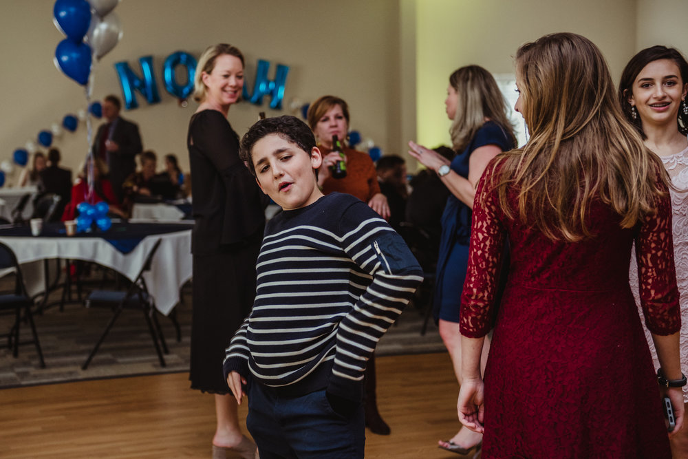 One of the guests poses for the camera as he dances during the mitzvah reception at Temple Beth Or.