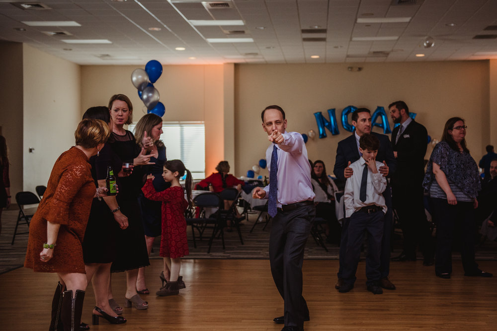 The family dances and has a great time during the bar mitzvah reception at Temple Beth Or in Raleigh.