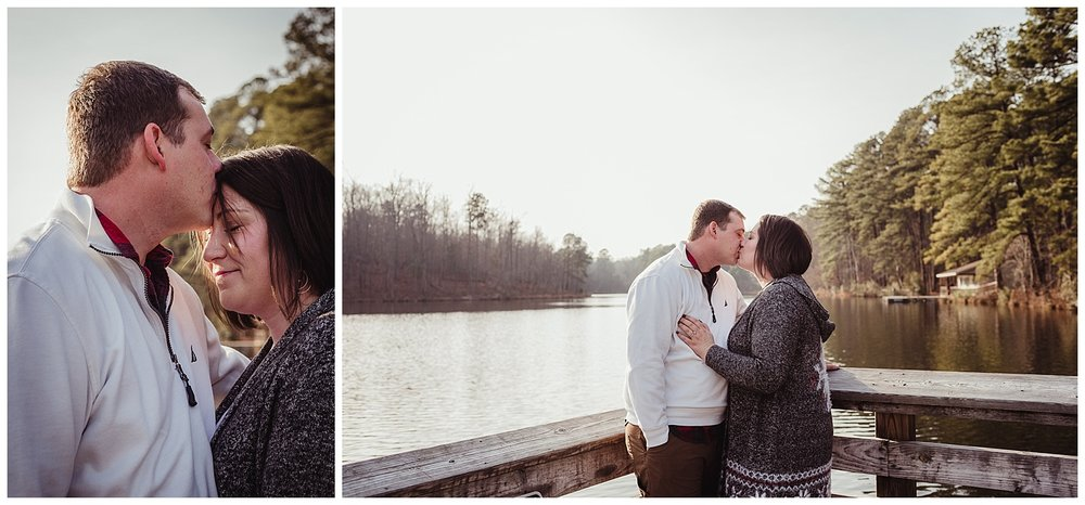 The engaged couple kiss on the dock at Durant Nature Park in Raleigh for their pictures with Rose Trail Images.