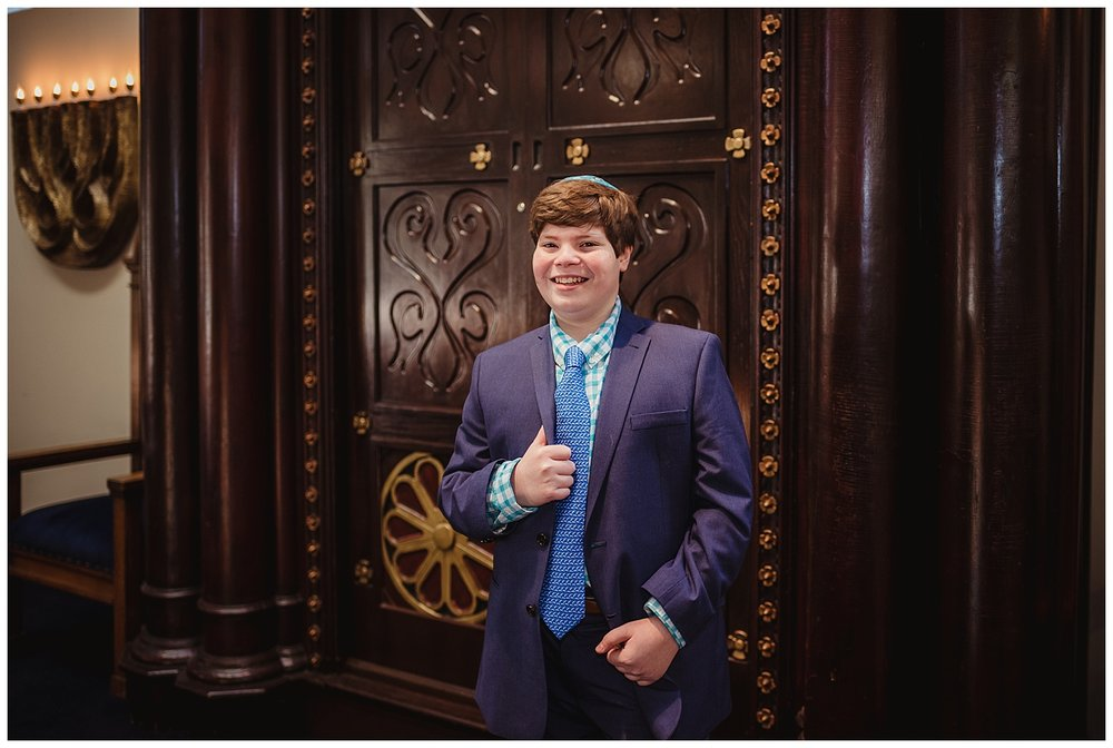 The Bar Mitzvah boy stands on the bema in front of the ark at Temple Beth Or in Raleigh, NC for Rose Trail Images.
