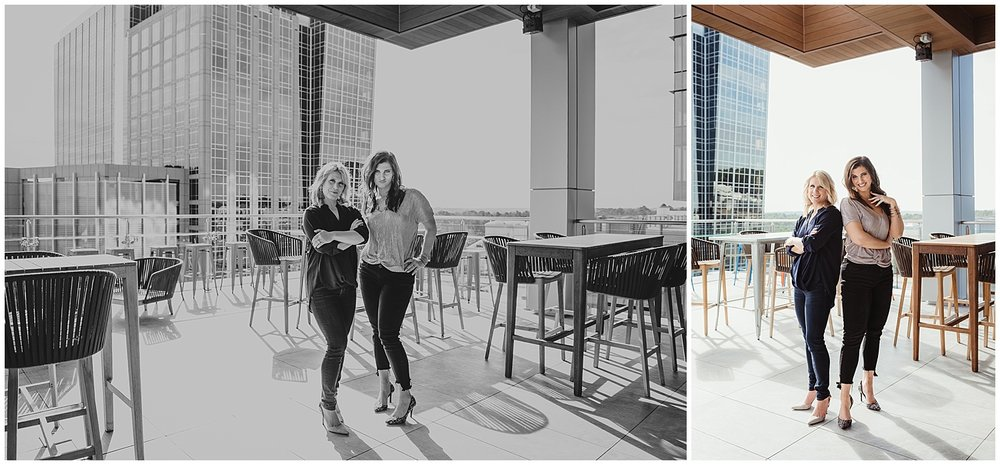 Sarah and Liz from Metro's Other Woman stand outside on the roof for head shots and branding photos with Rose Trail Images at Level7 Rooftop Bar in Raleigh, NC.
