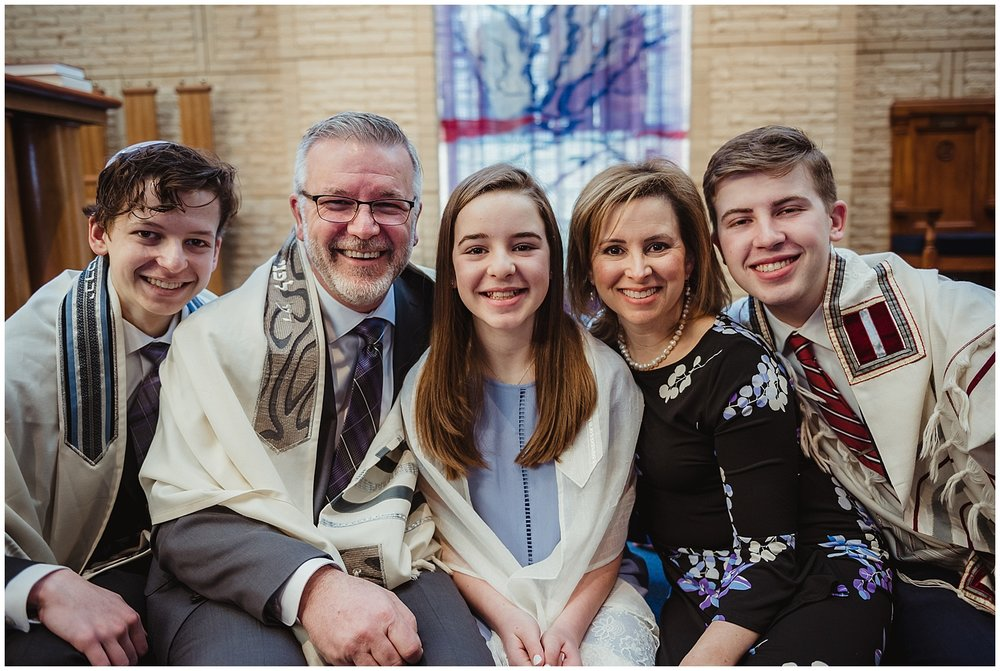 The Mitzvah girl and her family pose for pictures with Rose Trail Images while on the bema at Beth Meyer Synagogue in Raleigh, NC.