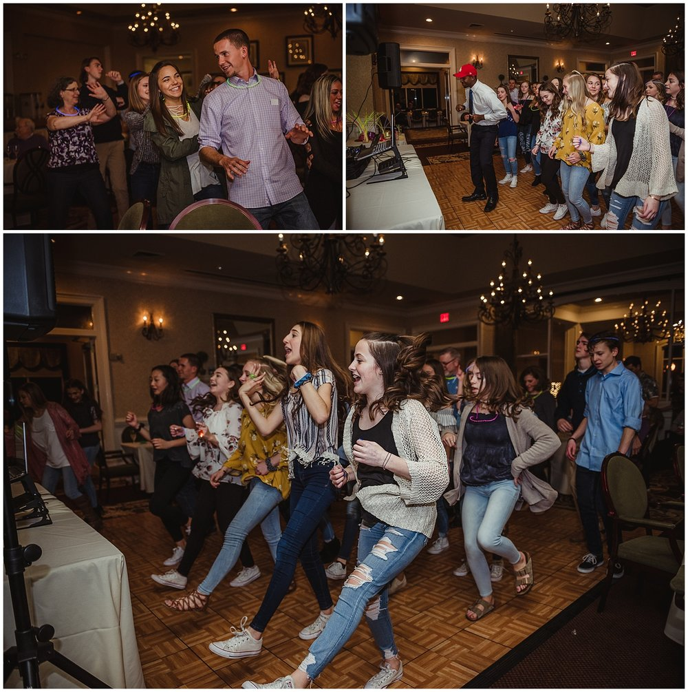Guests dance with the DJ during the mitzvah reception party at the Brier Creek Country Club in Raleigh, NC.