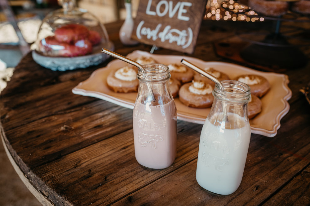 There was chocolate and regular milk to go with the donuts at the rustic farm styled engagement session with Rose Trail Images at Windy Hill Farm near Raleigh, NC.