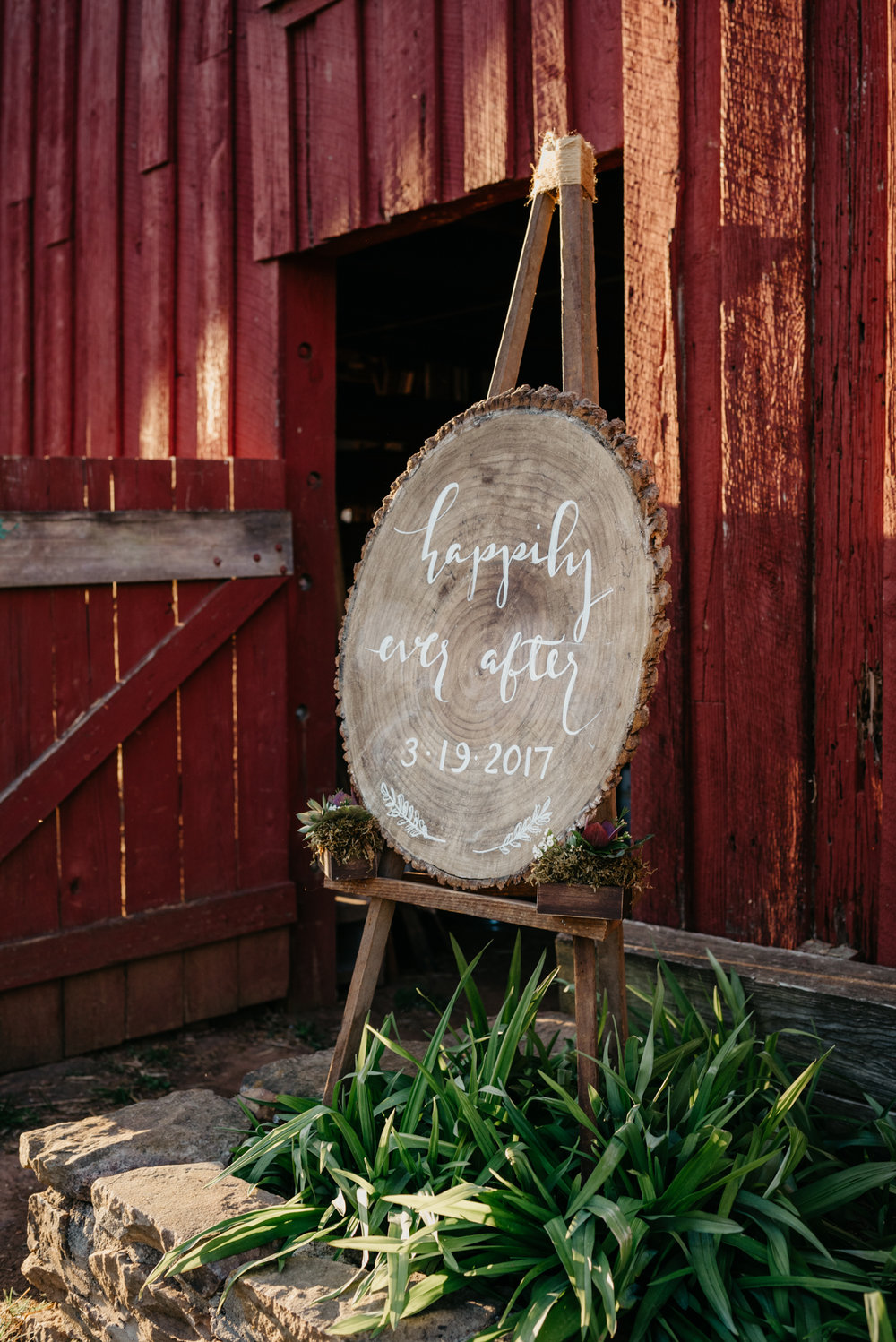 "The wooden sign saying ""happily ever after"" was setup outside by the barn at the rustic styled engagement session with Rose Trail Images at Windy Hill Farm near Raleigh, NC."