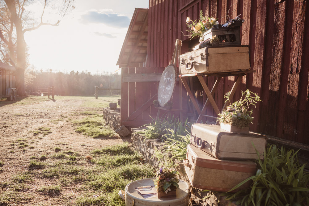 The decor is setup outside in the sunset at the rustic styled engagement session with Rose Trail Images at Windy Hill Farm near Raleigh, NC.