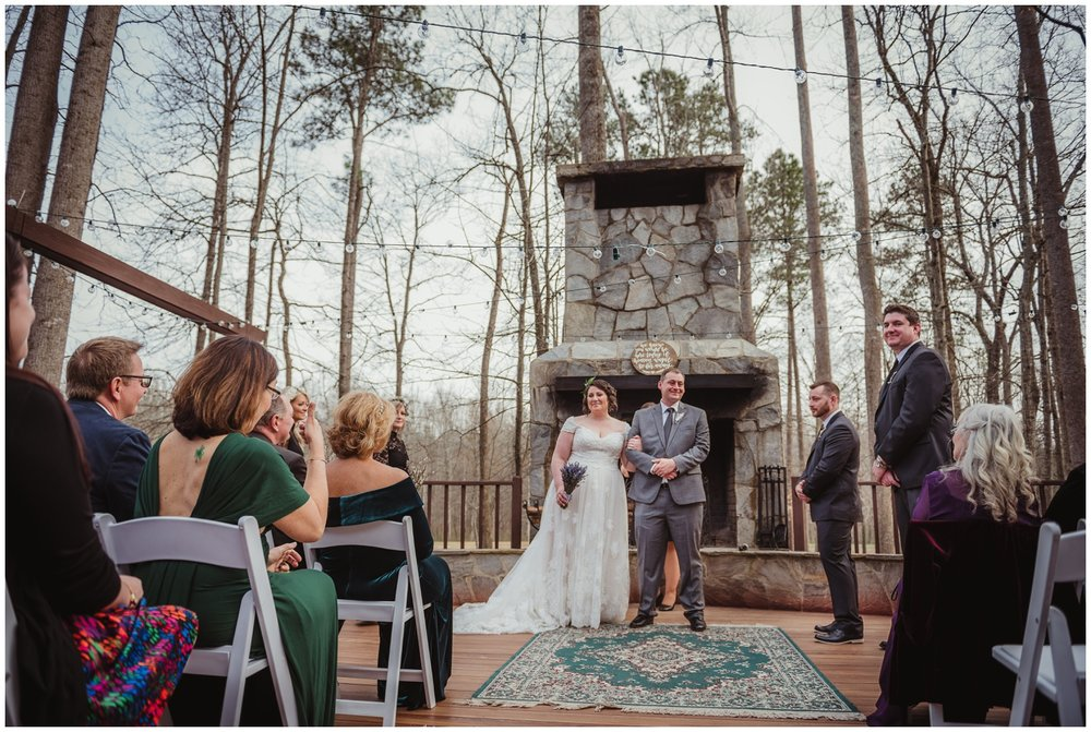 After the bride and groom exchange vows on their wedding day, they stop to stare at their family and friends at the Barn at Valhalla in Chapel Hill, taken by Rose Trail Images.