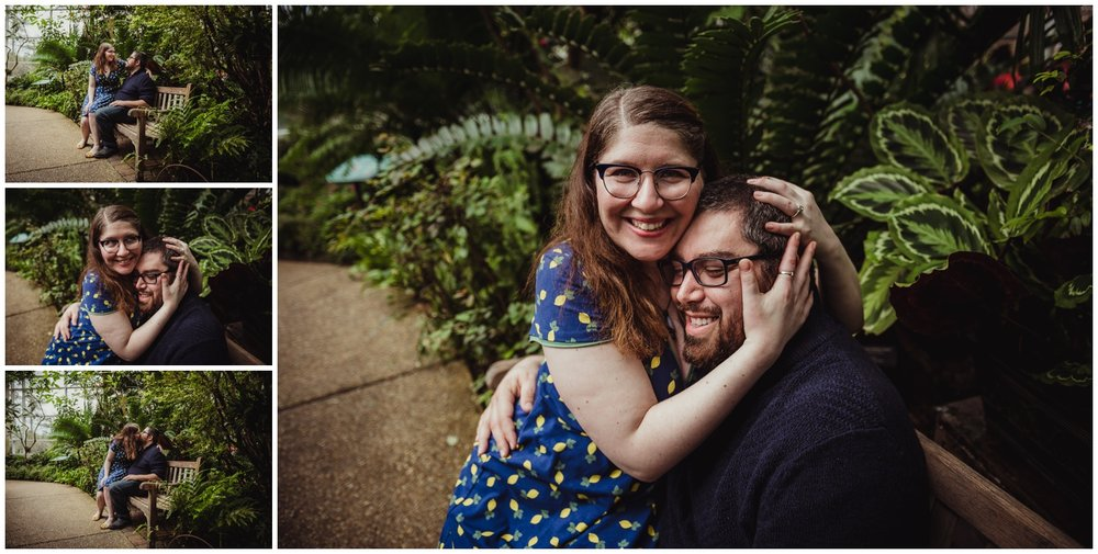 The couple share a quiet moment on a bench in the Butterfly House during their engagement photo session with Rose Trail Images in Durham, NC.