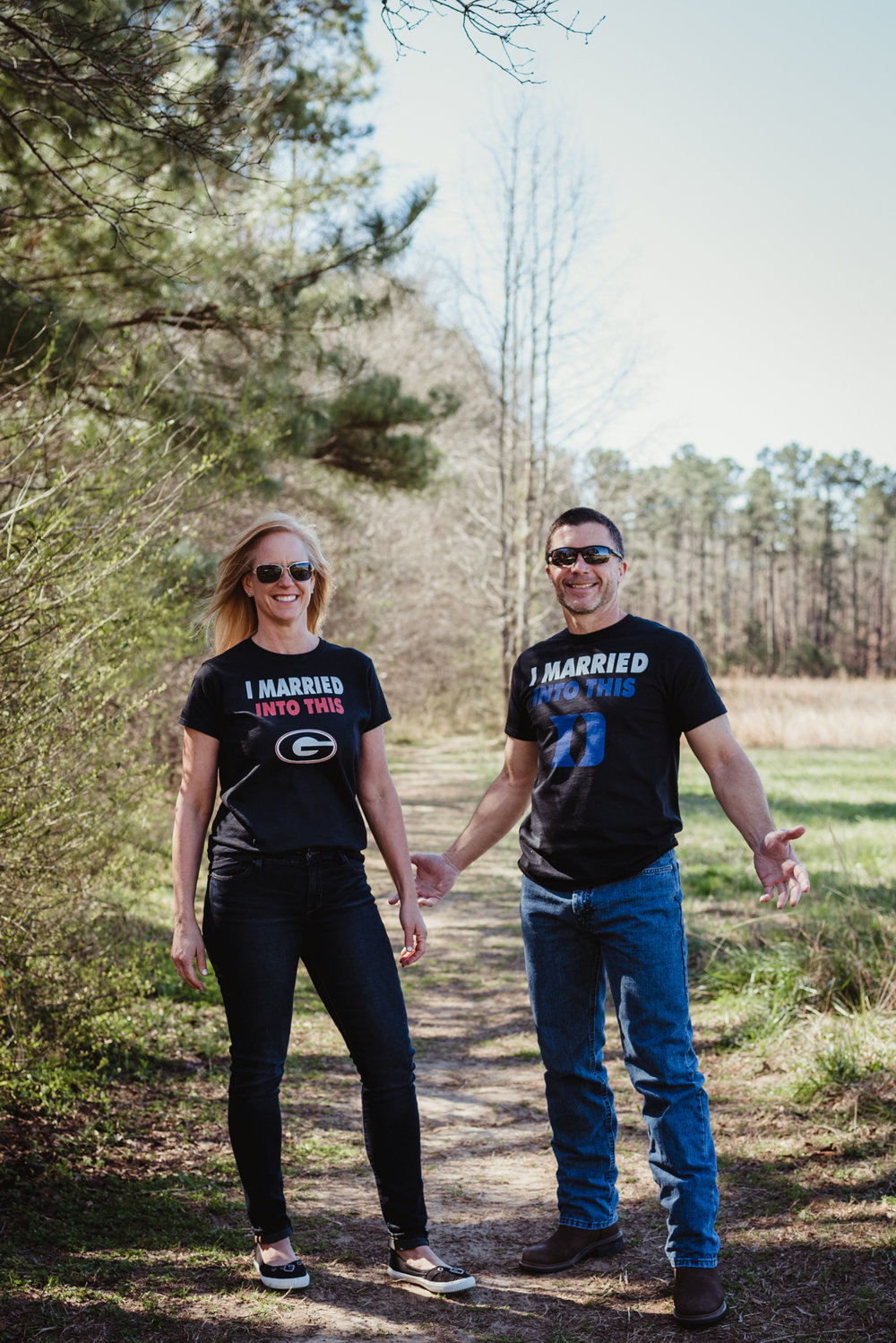 "They ""married into this"" Georgia Bulldog and Duke BlueDevils t-shirts during their engagement session with Rose Trail Images in Wake Forest, NC."