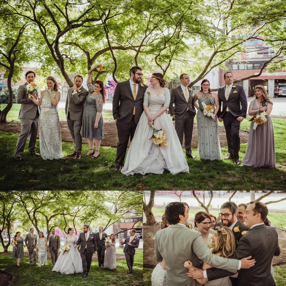 The bride and groom take pictures with their bridal party in the park before their wedding day in downtown Raleigh, picture by Rose Trail Images.