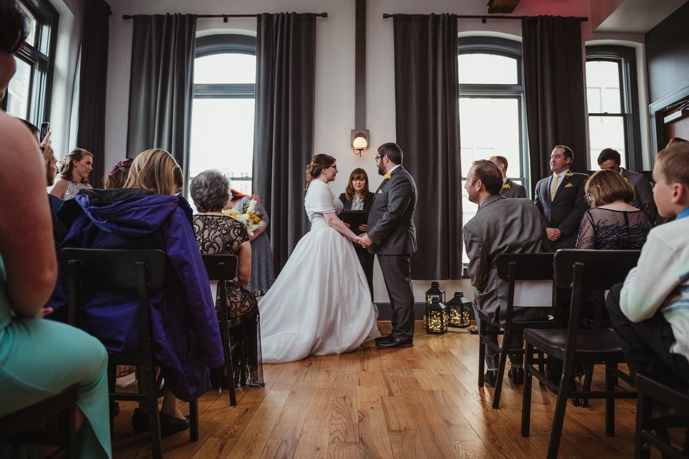 The bride and groom at their wedding ceremony at The Bridge Club in Raleigh, NC, picture by Rose Trail Images.