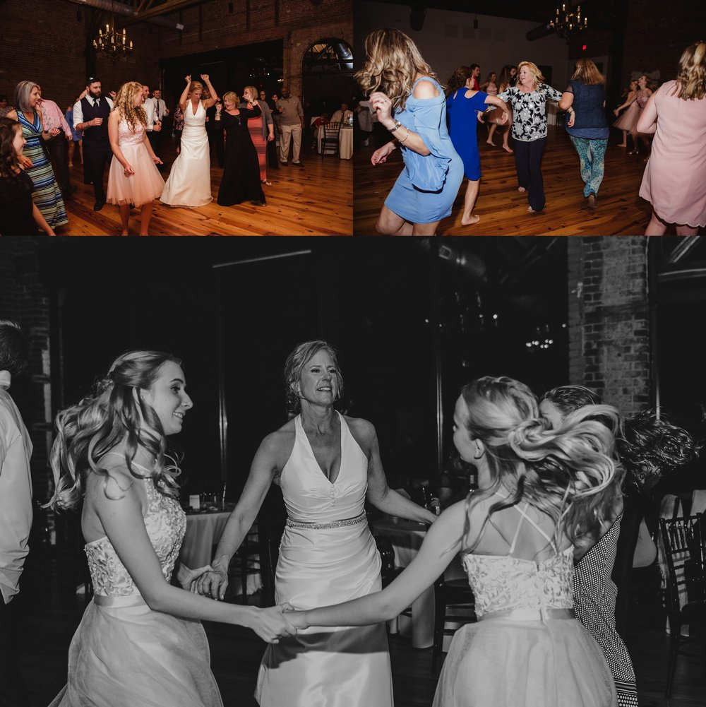 Guests enjoyed dancing at the wedding reception at Cross and Main in Youngsville, NC, images by Rose Trail Images.