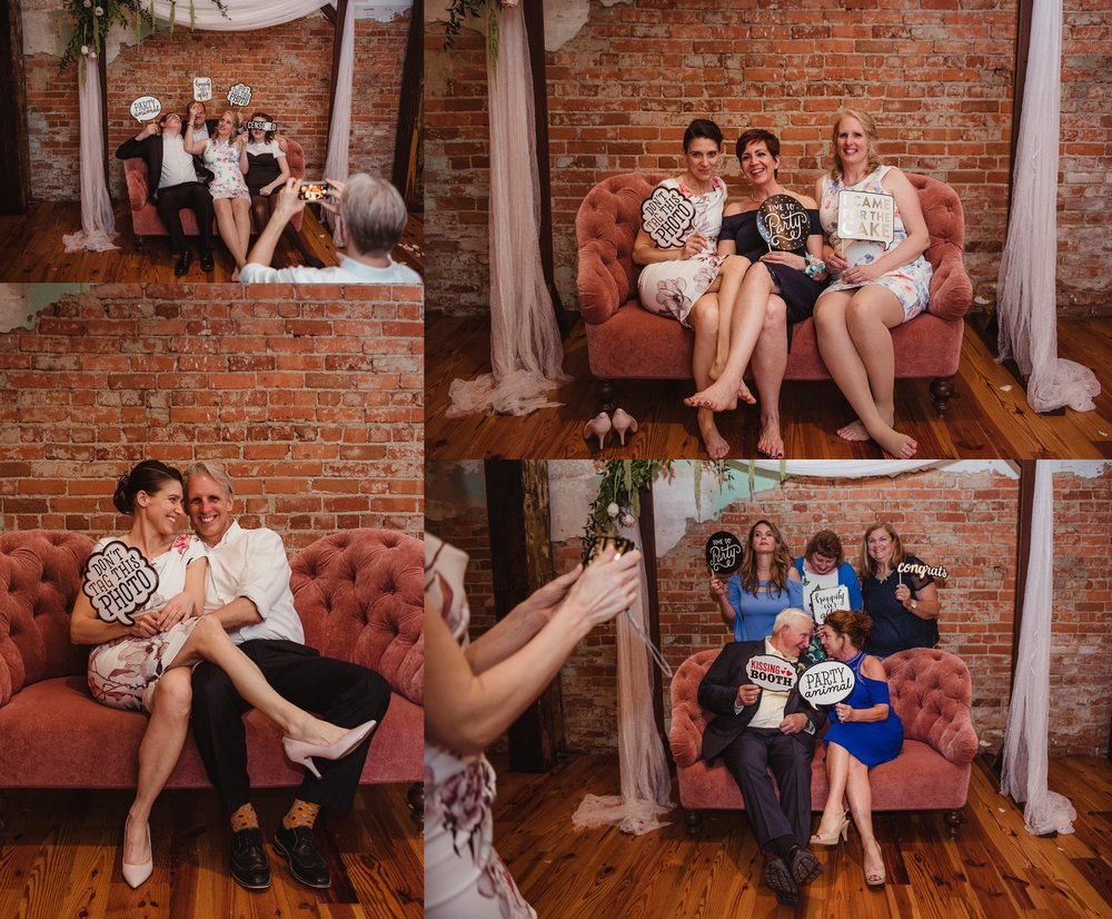 Guests enjoyed posing at the photo booth for Rose Trail Images at the wedding reception at Cross and Main in Youngsville, NC.