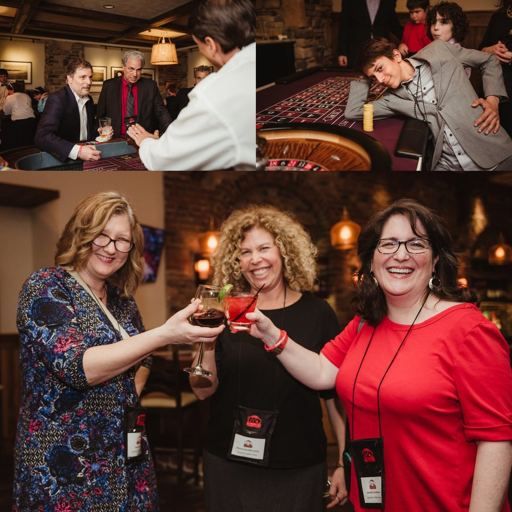 Guests playing craps and toasting at the casino themed mitzvah celebration at Mia Francesca of North Hills in Raleigh, North Carolina, pictures taken by Rose Trail Images.