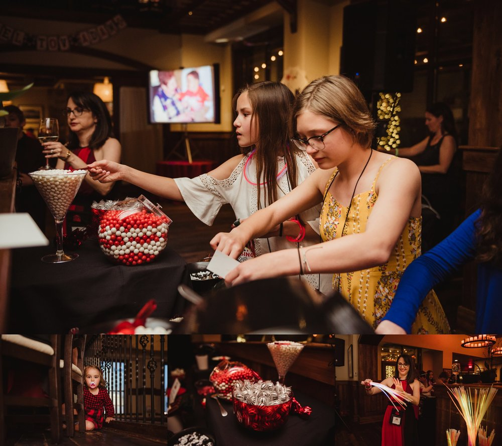 Guests enjoying the candy bar and glow sticks at the casino themed mitzvah celebration at Mia Francesca of North Hills in Raleigh, North Carolina, pictures taken by Rose Trail Images.