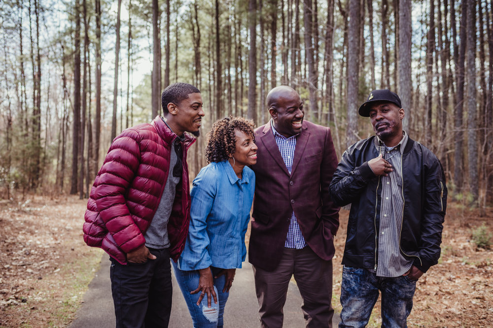 Mom and her three adult sons have a good time on the trail with Rose Trail Images in Rolesville Main Street Park.