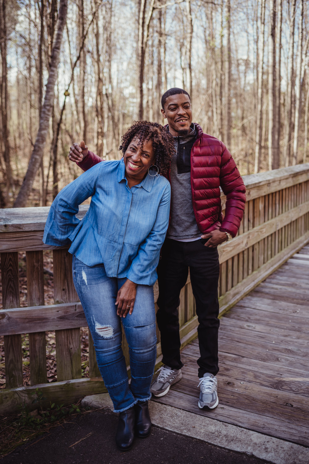 Mom poses for Rose Trail Images with her youngest adult son in Rolesville Main Street Park.