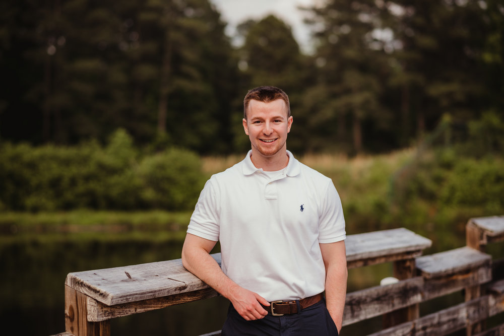 Harrison had his senior portraits done by the lake at Durant Nature Preserve in Raleigh, NC by Rose Trail Images.