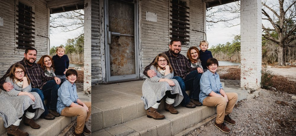 This family of five sat together in front of an abandoned store front at Lake Myra in Wendell, NC for their family pictures with Rose Trail Images.