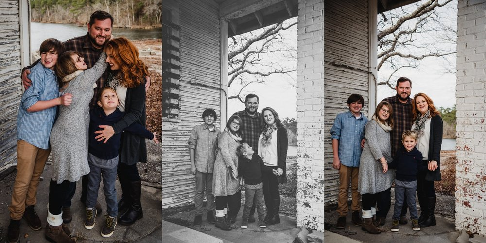 This family of five posed in front of an abandoned store front at Lake Myra in Wendell, NC for their family pictures with Rose Trail Images.