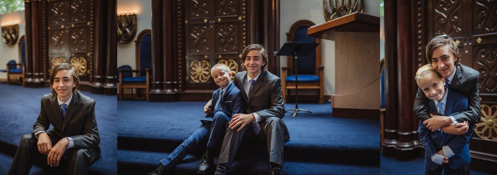 The bar mitzvah boy poses with his brother for Rose Trail Images in front of the ark at Temple Beth Or in Raleigh, North Carolina.