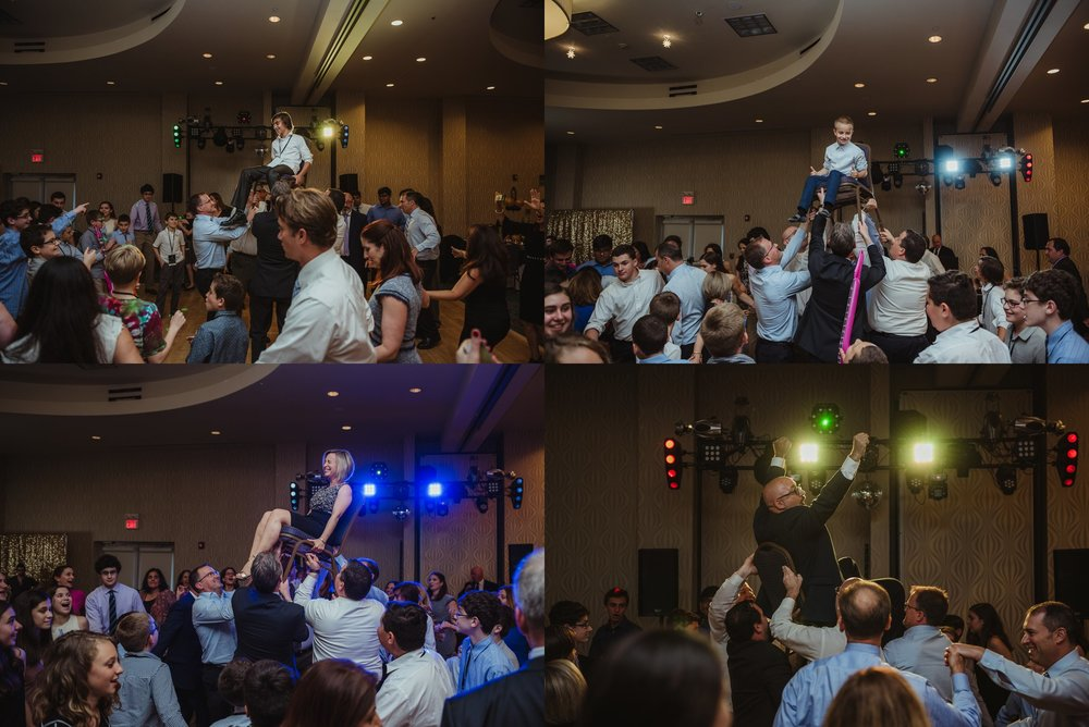 Joel and his family were raised in the chair for Hava Nagila at Joel's mitzvah celebration party at Embassy Suites in Raleigh, North Carolina, images by Rose Trail Images.