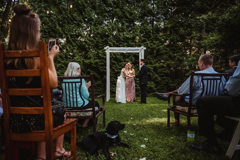 "The bride and groom said ""I do"" during their intimate wedding ceremony that took place in their backyard in downtown Raleigh, North Carolina, photo by Rose Trail Images."