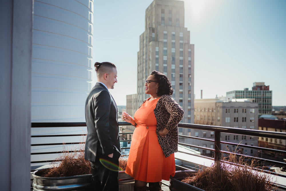 The husband and wife chat on the rooftop at the Durham Hotel in Durham, North Carolina, image by Rose Trail Images.