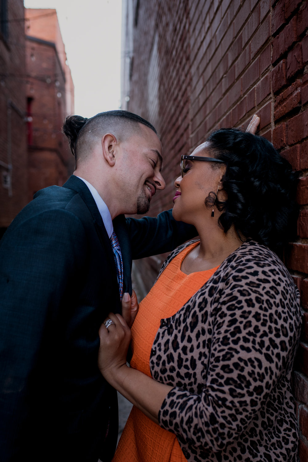 The husband and wife get really close in an alley way outside of The Durham Hotel in Durham, North Carolina, image by Rose Trail Images.